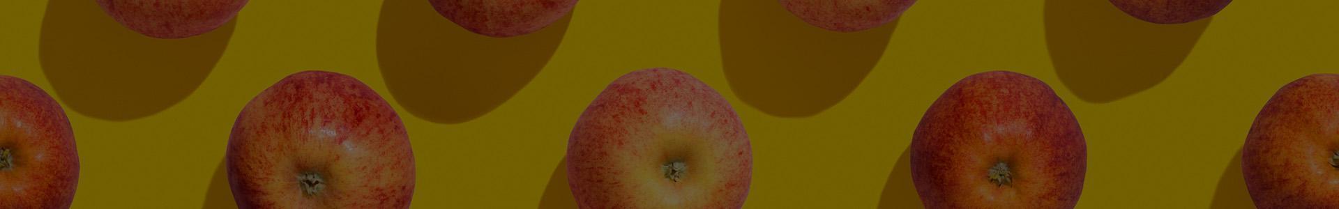 Jabłka na żółtym tle